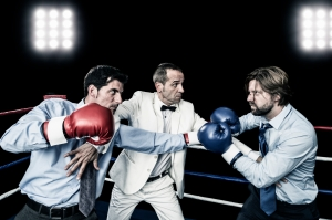 businessman fight in boxing ring