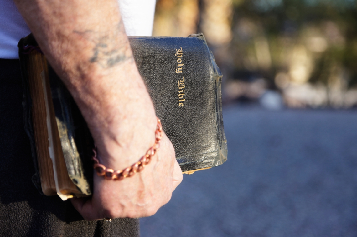 bible-antique-in-hand