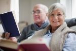 Smiling older couple reading books